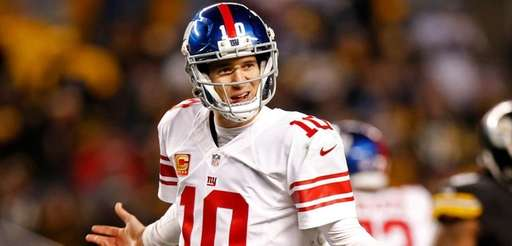 New York Giants quarterback Eli Manning questions a