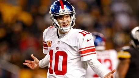 New York Giants quarterback Eli Manning questions a