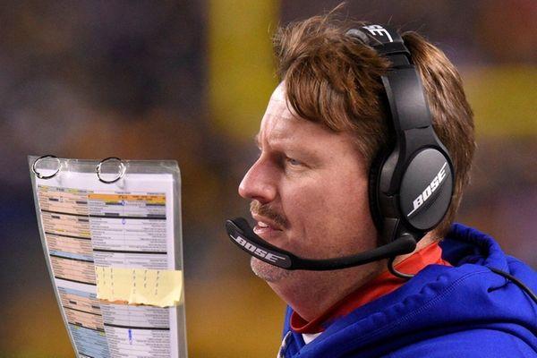 New York Giants head coach Ben McAdoo stands