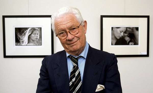 British photographer David Hamilton is shown in front