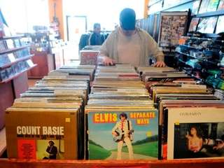 A customer browses through vinyl at Looney Tunes.