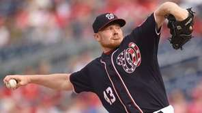 Mark Melancon of the Washington Nationals pitches in