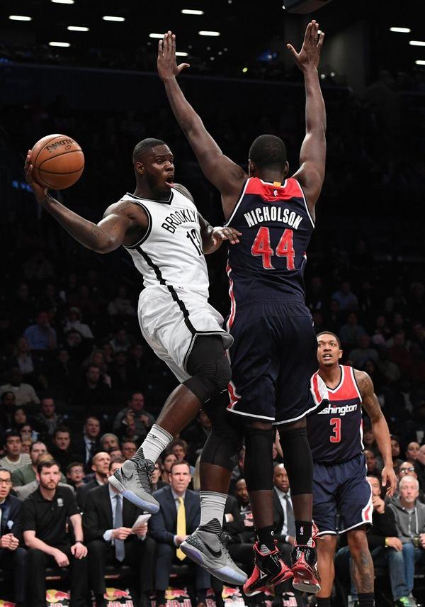 Brooklyn Nets forward Anthony Bennett passes the ball