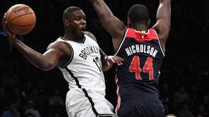 Brooklyn Nets forward Anthony Bennett passes the ball