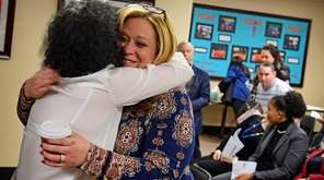 Linda Jacobs-Geller smiles as she hugs Plainview-Old Bethpage