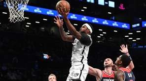 Brooklyn Nets forward Trevor Booker sinks a layup