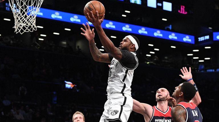 Brooklyn Nets forward Trevor Booker sinks a layup