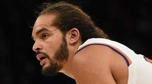 Knicks center Joakim Noah looks on against the