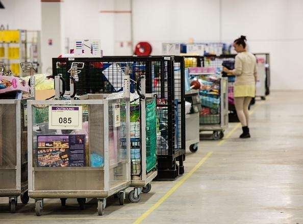 An Amazon employee works in a logistic site