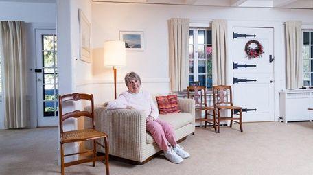 Lynn Morris, 84, relaxes in the living room