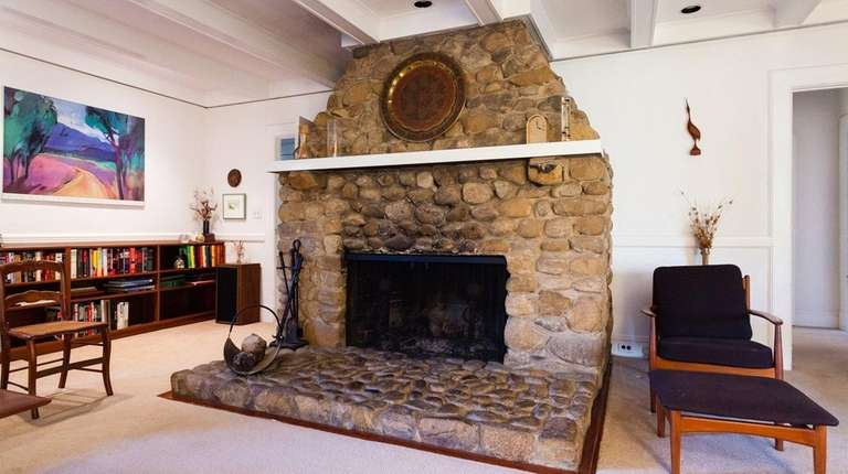 The stone fireplace is the focal point in
