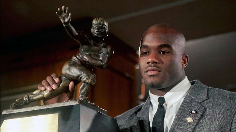 Colorado's Rashaan Salaam poses with his 1994 Heisman