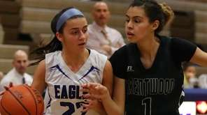 Hauppauge's Kayla Petre #22 drives to the hoop
