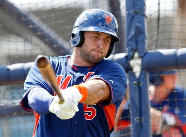 Mets' Tim Tebow practices his swing during batting