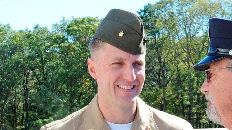Marine major Jason Brezler, left, in front of