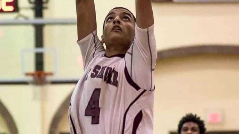 Bay Shore's Jose Rivera goes for a dunk