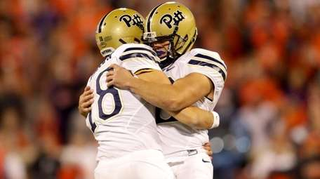 Chris Blewitt celebrates with teammate Ryan Winslow of
