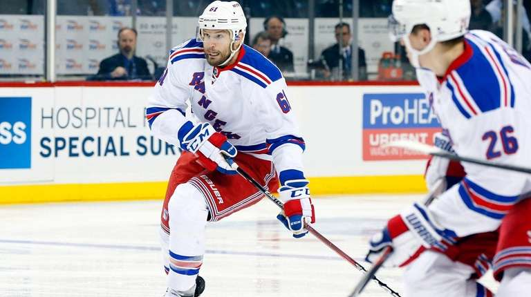 Rick Nash brings the puck up against the