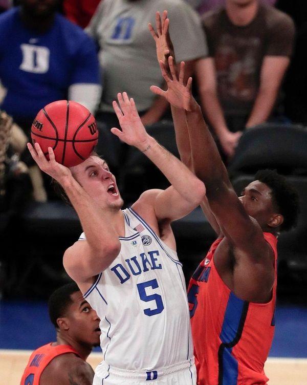 Duke guard Luke Kennard puts up a shot