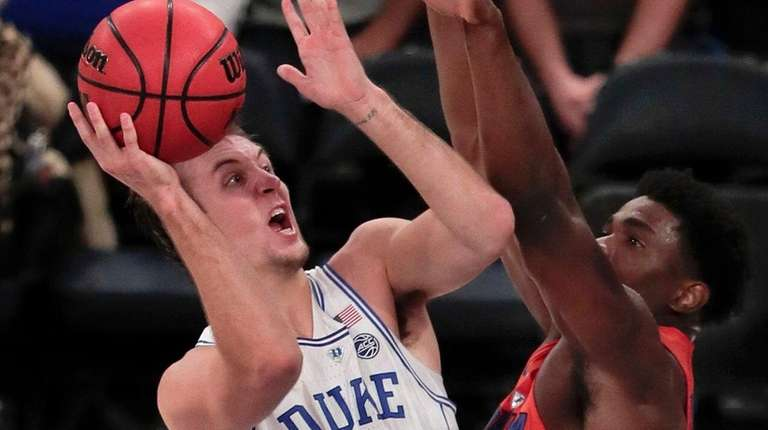 Duke guard Luke Kennard puts up a shot