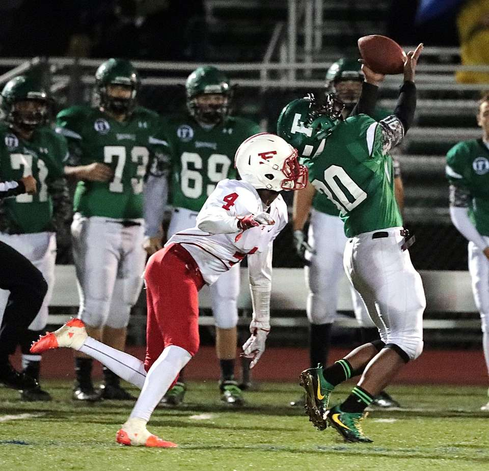 Farmingdale's Jordan Mclune (30) tries to hold onto