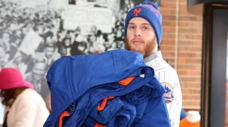 Mets pitcher Zack Wheeler enters the team store