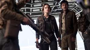 Felicity Jones, left, stars as Jyn Erso and