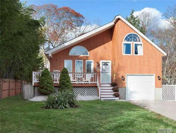 This three-bedroom, two-bath Contemporary in Shirley is hosting