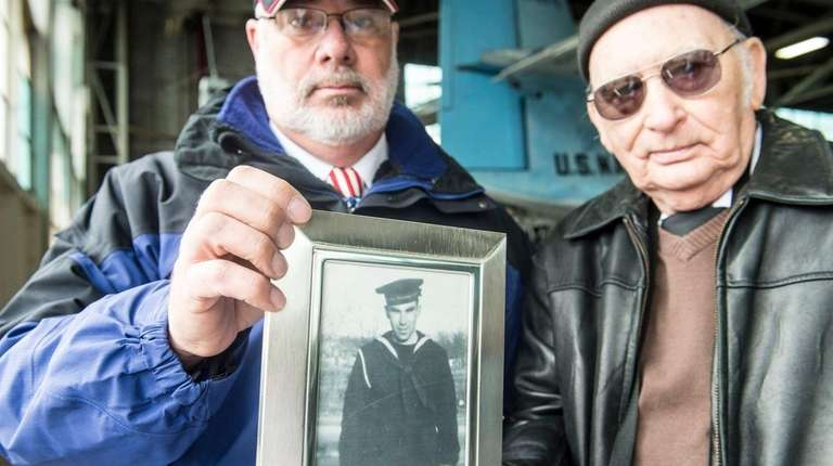 Ken Schultz and Gary Jayne hold a photo
