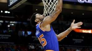 New York Knicks guard Derrick Rose shoots over