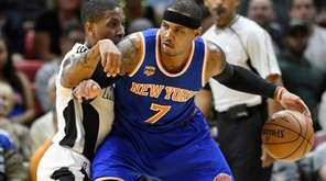 New York Knicks' Carmelo Anthony, right, is defended
