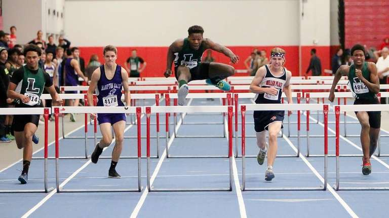 Longwood's Jaheim Dotson wins the 55-meter hurdles during