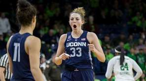 Connecticut's Katie Lou Samuelson celebrates as she comes