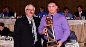 Ryan O'Shea of MacArthur is presented the Martone