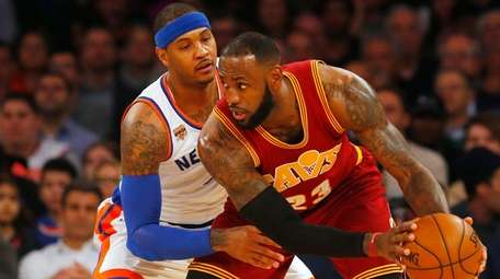LeBron James of the Cleveland Cavaliers controls the