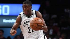 Nets guard Caris LeVert brings the ball upcourt