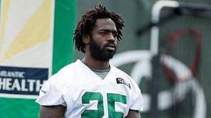 New York Jets running back Joe McKnight looks
