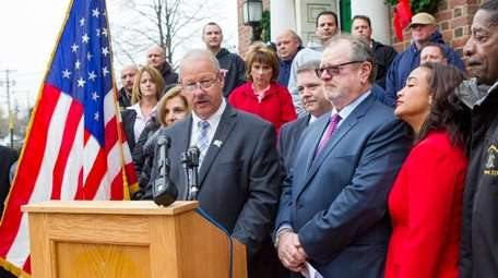 Freeport Mayor Robert Kennedy announces a reduction in