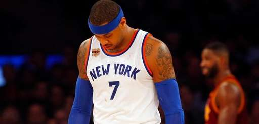 Carmelo Anthony of the New York Knicks walks
