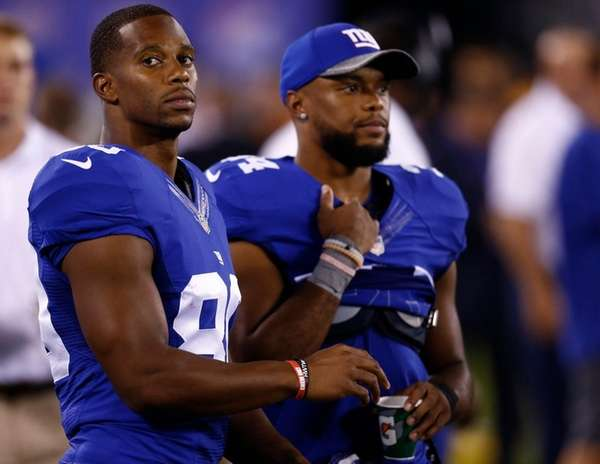 Victor Cruz, left, and Shane Vereen stand on