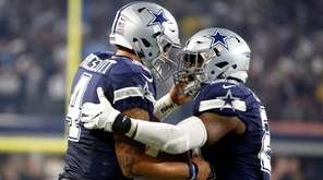 Dallas Cowboys quarterback Dak Prescott, left, and running