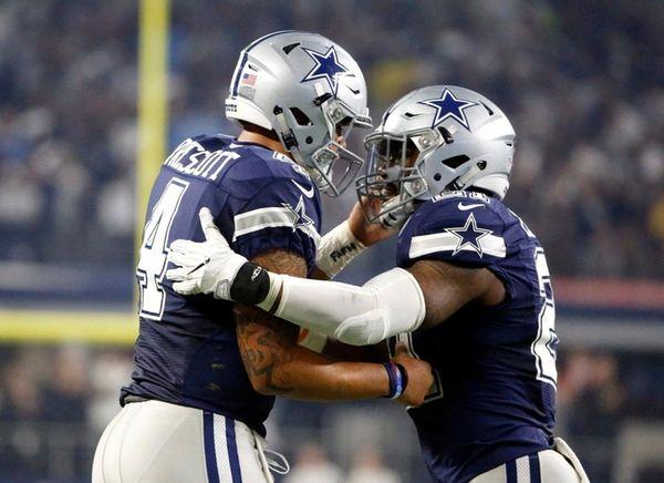 Dallas Cowboys quarterback Dak Prescott, left, and running