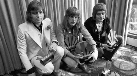 Greg Lake, left, with bandmates Keith Emerson and