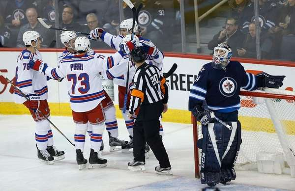 Winnipeg Jets goaltender Michael Hutchinson (34) looks up