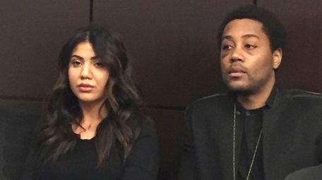 Jasmine Besiso and her boyfriend, Myrone Powell, listen,