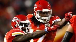 The Kansas City Chiefs' Chris Conley, right, points