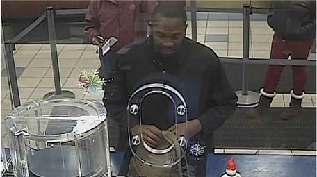 Nassau County Robbery Squad detectives released surveillance images
