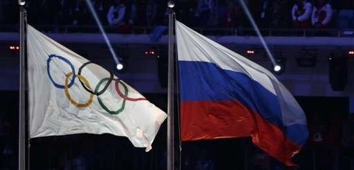 The Russian national flag, right, flies after next