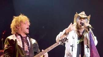 C.C. DeVille, left, and Bret Michaels perform at