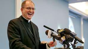 Bishop John O. Barres speaks to the media
